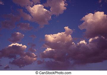 Interesting clouds in blue sky.