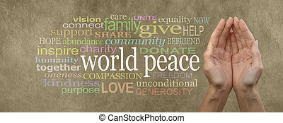 Female cupped hands palm up with the words 'world peace' in white on the left surrounded by a relevant word cloud on beige colored stone effect background