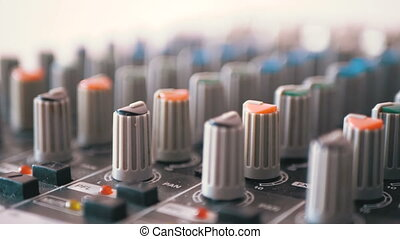 Control knobs on a sound mixing console. Fade sliders...