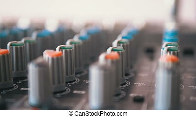 Control knobs on a sound mixing console