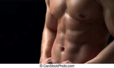 Control of Abdominal Muscles - Close up of male press...