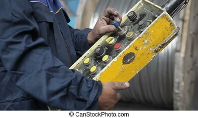 Control panel in hands - The control panel in the hands of...