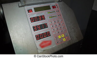 control panel with red digits on the display monitor panel red button with buttons