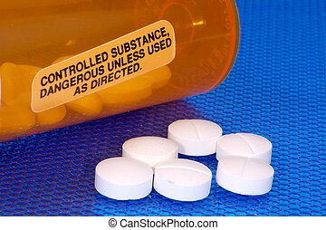 Controlled Substance - Pills and a Warning Label