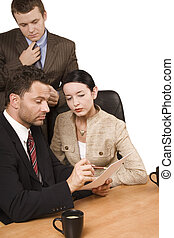 controlling - 3 people reading report at the desk - isolated...