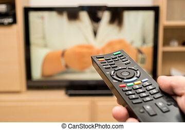 controllo, televisione, moderno, remoto, dof., tv guardante, poco profondo, controller., mano, fondo., nero, presa a terra, usando