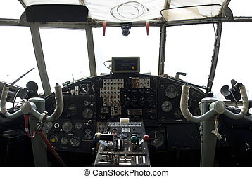 controls and equipment in cockpit of veteran airplane