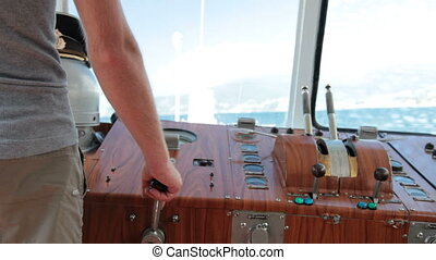 controls boat in the wheelhouse