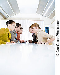Photo of business people staring at each other with aggressive expression