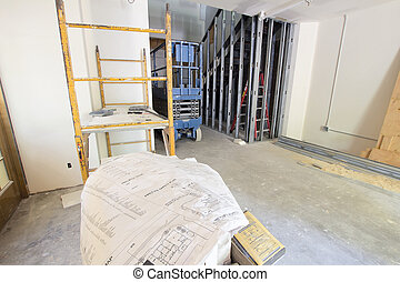 Construction Site at Commercial Space with Architect Blueprint Plan