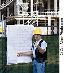contruction worker with blue prints