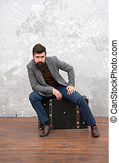 Convenient way to travel. business trip adventure. trendy businessman with luxuty suitcase for traveling. vintage and retro style. grunge background. bearded man with travel bag. fashion look