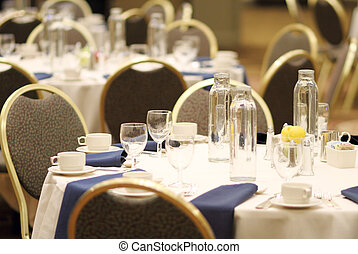 Convention banquet chairs and tables at a hotel.