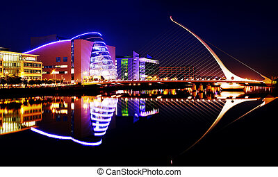 Barrel shaped Dublin Convention Center (The CCD) by the American-Irish architect Kevin Roche and Samuel Beckett Bridge by architect Santiago Calatrava in Dublin City Centre