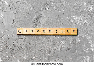 convention word written on wood block. convention text on cement table for your desing, concept