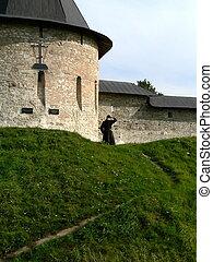 Conventual wall - Monk beside conventual wall
