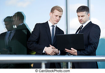 Conversation before business meeting - Horizontal view of...