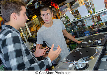 conversation in a disc jockey shop