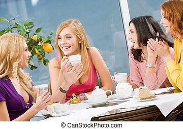 Conversation - Friendly conversation of four pretty girls...
