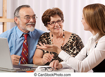 conversation - Senior couple meeting with agent or advisor