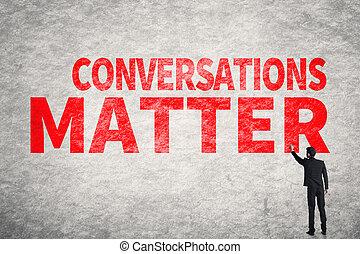 Conversations Matter - Asian business man write words on...