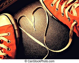 Hot pick converse shoes with the laces in the shape of a heart.