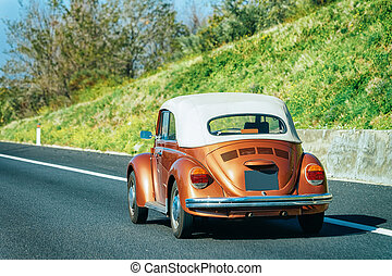 Convertable little cabriolet Car on road in Italy