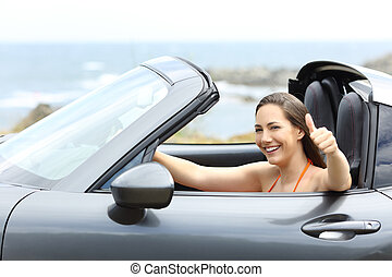 Convertible car driver with thumbs up