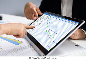 Convertible Laptop With Gantt Software Chart And Agenda