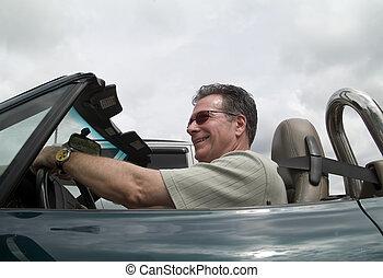 Convertible Pleasures - A man enjoying driving his...