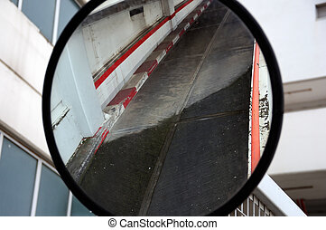 Parking driveway mirrored on convex curved mirror.