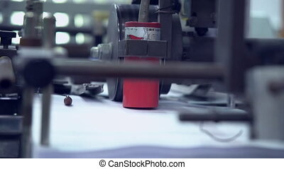 conveyor belt in a printing factory - close up moving...