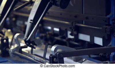 conveyor belt in a printing press - close up white sheets on...