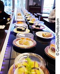conveyor belt sushi - sushi belt with sushi dishes in a...