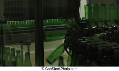 Conveyor belt with glass bottles for bottling beer.