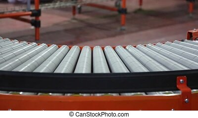 Conveyor Curve - Shipping Boxes at Conveyer Belt in...