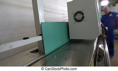 Conveyor mechanism for glass processing - Closeup detail of ...