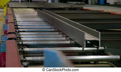 Conveyor of Automated machine cuting metal in Industrial...
