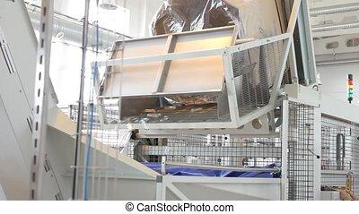 Conveyor production of plastic bottles.