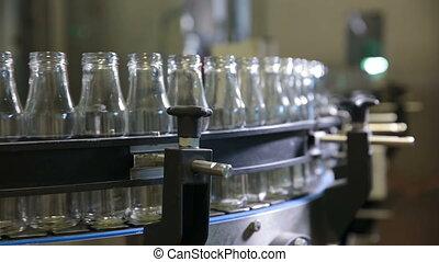 Conveyor with milk bottles.