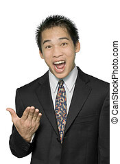 Close-up of young dynamic smiling and enthusiastic Asian businessman or salesman in suit making an explaining or convincing gesture with his hand. Isolated over white.