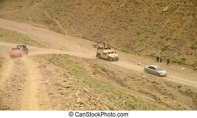 Convoying an armored truck - A high angle long shot of a...