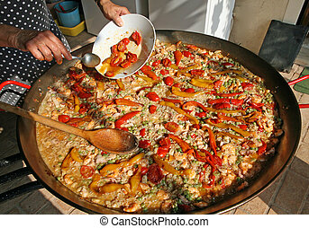 Cook as you add the red tomatoes to large skillet rice with fish and vegetables