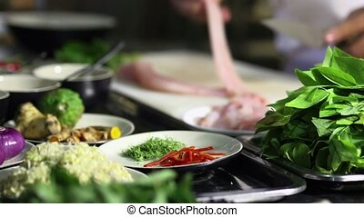 Cook at work in Asian restaurant - Food preparation with ...