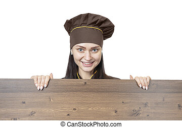 cook behind a wooden board