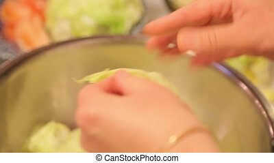 Cook clears the cabbage in a bowl