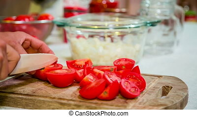 Cook Cutting Tomatoes Into Parts