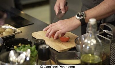 Cook cutting tomatoes