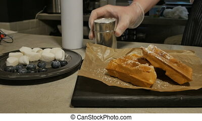 Cook decorating waffles - Unrecognizable cook decorating...