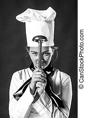 cook hiolding pan - Photo of a cook playing with ladle.